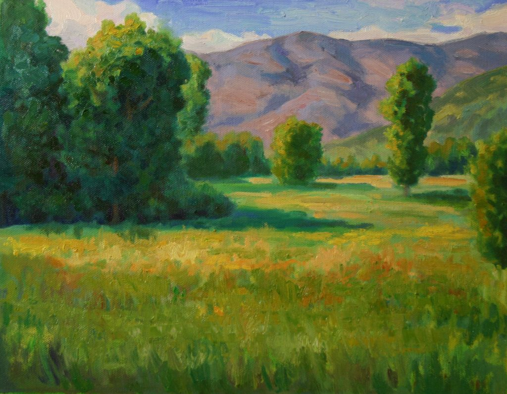 Small works holiday show Plein Air Impressionist painting of Meadow Trees and mountains in Idaho by Fine artist Kevin McCain