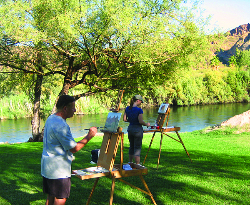 Photograph of landscape painting workshops students studying plein air painting with artist Kevin McCain